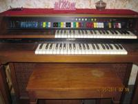 It's a Lowrey piano organ, jamboree with majic genie.