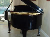 Gorgeous polished ebony baby grand piano for sale by