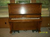 Piano upright, Metal plate says 64 years of H. Kleber &