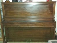 Piano made in 1911. Still in tune. Very heavy. Local