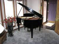 Beautiful, black lacquer finish 5' Baby Grand Piano. No