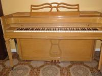 "A blond colored ""Acrosonic"" Piano. A product of"