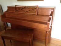 Estey upright piano with violin bridge building.