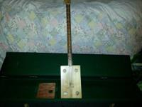 Nice Brand NEW pickin stick. Has electric pick up. Very