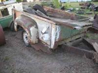 not sure pickup make, needs tires, steel floor appears