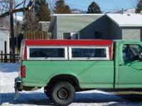 Pickup topper that has two lift up opening windows on