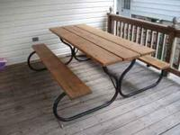 Up for sale is a metal frame picnic table. The wood top