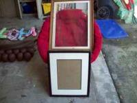 1 wood picture frame with border , glass and wall