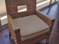 Pier1 woven wicker chair and taupe cushion with