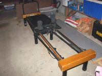 Here is a barely used pilates machine made by Stamina