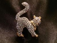 This Cat Pin is made from Austrain Crystal with gold