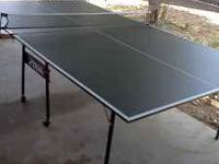 A BIG PIN PONG TABLE FOR SALE $100.00 OR BETTER OFFER