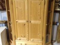 Used raw Solid Pine entertainment Center. It is made to