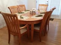 This is a 9 year old pine oval dining room table. The