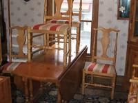 Pine drop leaf round table. Includes 6 chairs with