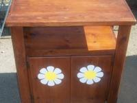 This is a solid pine wood cabinet. It can be used as a