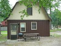 Pet and kid friendly!! Four lakefront cottages and main