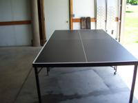 Table by Harvard Sports. Includes net, balls and 4