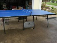 nice ping pong table with paddles and glow in the dark