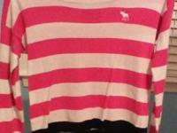 Soft pink and white striped scoop neck sweater with a