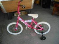 I have a pink Barbie little ladies bike w / training