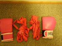 Pink boxing gloves with wraps.  Good condition no