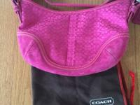 "hot pink coach purse with signature ""c"" printed all"