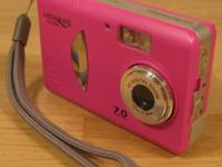Model is Vistaquest VQ7220. It is a 7.0 mp. It uses 2