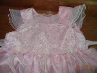 Great pink dress for a sweet little lady. Brand name is