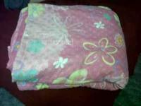 Twin size pink flowered comforter set. Includes one