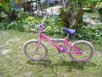 Eye popping Pink bicycle with a Purple seat Sheer Fun
