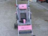 This is a very cute pink stroller by Jeep. It has been