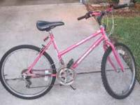 Pink mountain bike. Great for a teenager and up. In