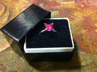 Pink Saphire real nice princess cut on 12 k gold band,