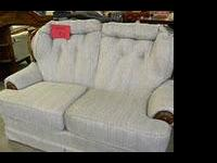 Nice Loveseat with small pinstripe pattern and wood