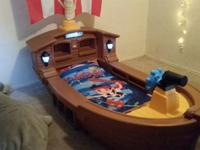 This is a little tikes pirate ship bed. asking $120.