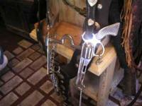 Nice Silver Concho bridle with Pistol Grip Bit. Silver