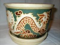 This vintage Asian Planter with underplate has dragons