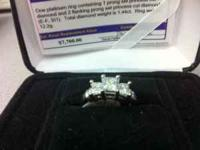 Princess cut 3 stone engagement ring set in platinum