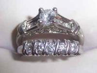 Engagement ring is platinum with one large diamond in