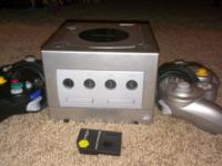 Used Gamecube with 7 games, 2 controllers, and 1 memory
