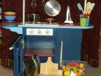 For sale is an adorable play kitchen w. tons of