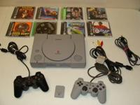 Up for sale is a Play Station 1 System with (2)