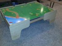Large play table with scenery on one side and green on