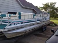 1993 Playbouy Pontoon. It has the 4 cylinder Mercruiser