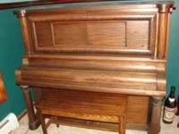 Antique player piano with hundreds of player rolls. In