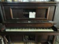 Old player piano with Rolls, will take $700 or BEST