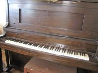 Standard player piano with bench and approx 80 player
