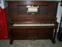 This is a Howard Player Piano of Cincinnati and Chicago