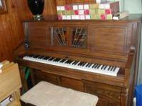 Player Piano from 1980's, with over 30 music rolls.